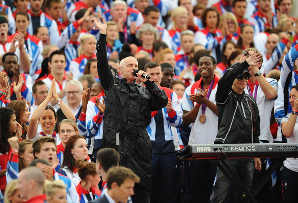 "The Pet Shop Boys sing their Olympic Anthem, ""Winner"" as the Athletes assemble."