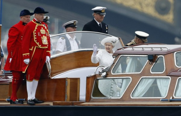 The Queen being escorted to her Royal Barge